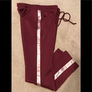 Burgundy colored track pants sz large